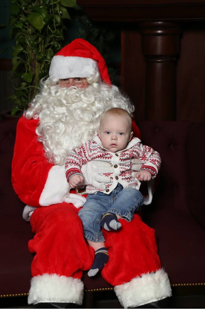 Littlest Laker poses with Santa